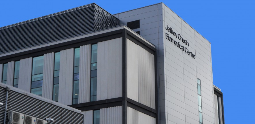 Photo of the Jeffrey Cheah Biomedical Centre against a clear blue sky