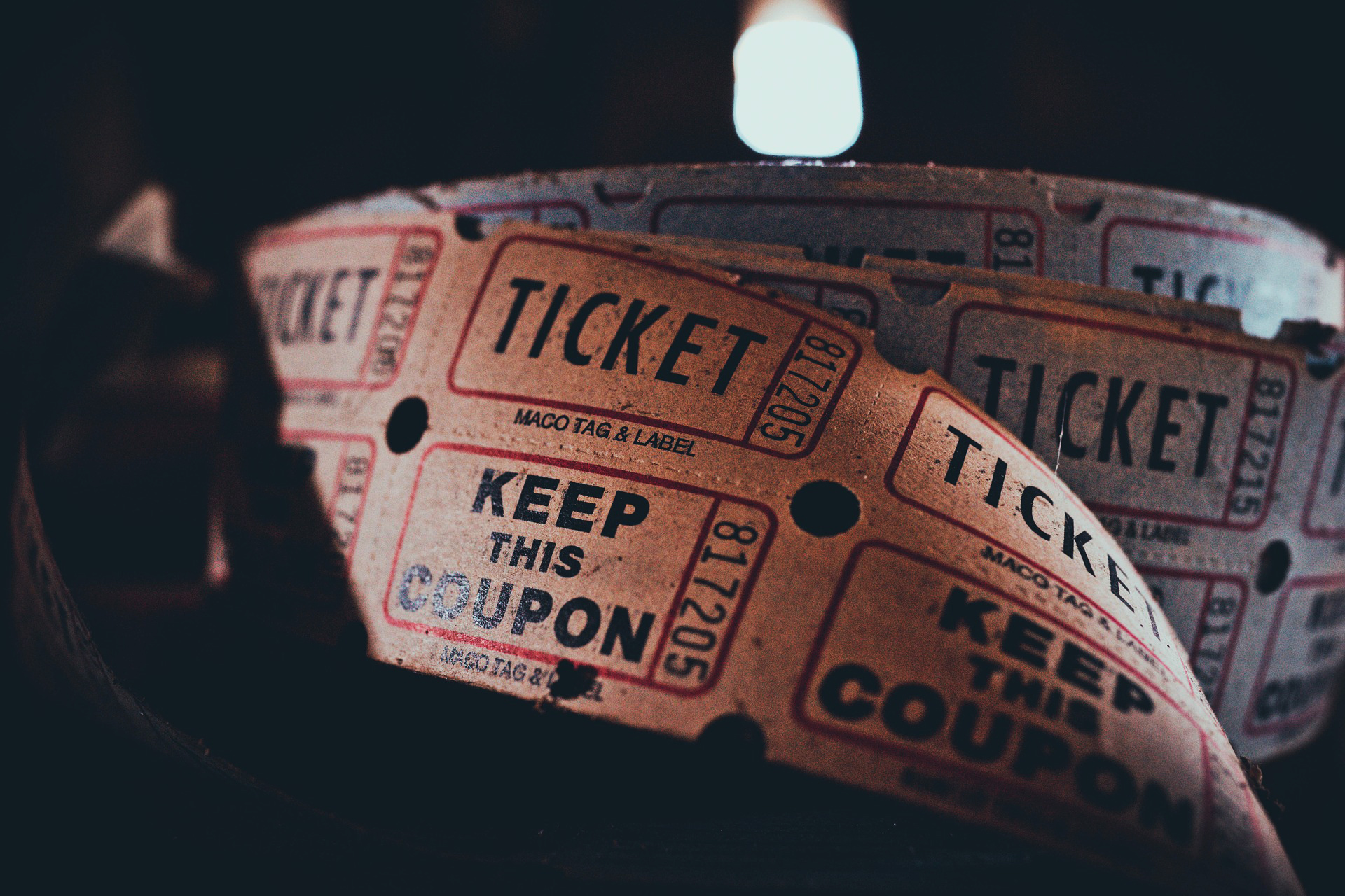 A strip of old-fashioned paper tickets